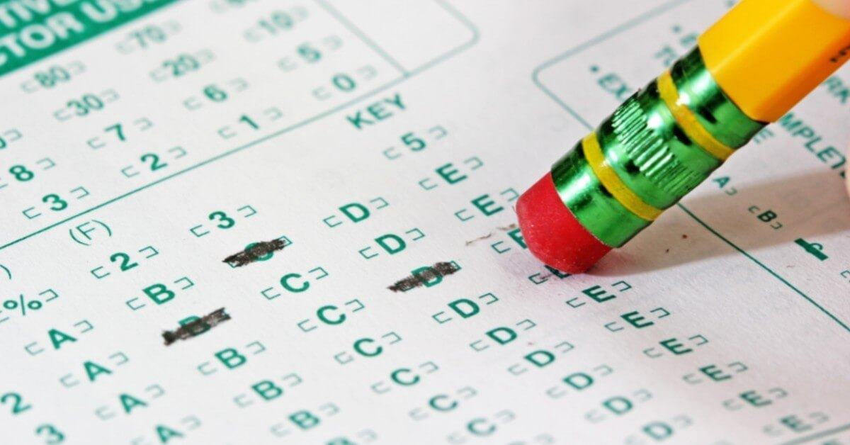 filling in a test sheet on an EPA Section 608 exam