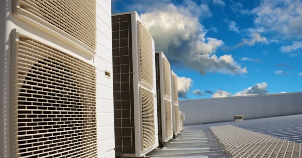 HVAC systems on a business roof with blue skies overhead